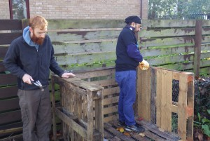 Building the compost bins out of wooden pallets